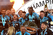 Captain of The Soccer Aid World XI, Usain Bolt lifts the trophy as he celebrates with team mates during the 2019 Soccer Aid for UNICEF match between England and Soccer Aid World XI at Stamford Bridge on June 16, 2019 in London, England.
