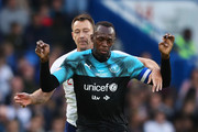 Usain Bolt of Soccer Aid World XI shields from John Terry of England during the Soccer Aid for UNICEF 2019 match between England and the Soccer Aid World XI at Stamford Bridge on June 16, 2019 in London, England.
