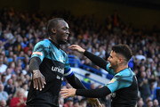 Usain Bolt of Soccer Aid World XI celebrates as he scores his team's first goal with Billy Wingrove during the Soccer Aid for UNICEF 2019 match between England and the Soccer Aid World XI at Stamford Bridge on June 16, 2019 in London, England.