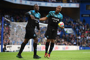 Usain Bolt of Soccer Aid World XI celebrates as he scores his team's first goal with Didier Drogba during the Soccer Aid for UNICEF 2019 match between England and the Soccer Aid World XI at Stamford Bridge on June 16, 2019 in London, England.