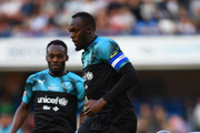 Usain Bolt of Soccer Aid World XI evades SIr Mo Farah of England during the Soccer Aid for UNICEF 2019 match between England and the Soccer Aid World XI at Stamford Bridge on June 16, 2019 in London, England.