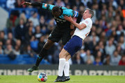 Usain Bolt of Soccer Aid World XI holds off Jamie Carragher of England during the Soccer Aid for UNICEF 2019 match between England and the Soccer Aid World XI at Stamford Bridge on June 16, 2019 in London, England.
