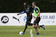 Usain Bolt and Kevin Pietersen of the Rest of the World take part in training during Soccer Aid for UNICEF media access at Fulham FC training ground on June 8, 2018 in New Malden, England.