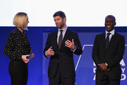 Amanda Davies (L), CNN International Sports presenter talks with Thomas Hitzlsperger, former German International and Clarence Seedorf, former Netherlands International during the presentation of the first-ever FIFA Diversity Award on day 1 of the Soccerex Global Convention 2016 at Manchester Central Convention Complex on September 26, 2016 in Manchester, England.