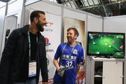 Ruud van Nistelrooy talks to a representative on the Owl & Fox stand during day 1 of the Soccerex Global Convention at Manchester Central Convention Complex on September 4, 2017 in Manchester, England.