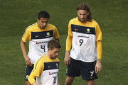 Harry Kewell of Australia controls the ball as Tim Cahill and Josh Kennedy look on during an Australian Socceroos training session at St Stithians College on May 31, 2010 in Sandton, South Africa.