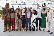 (L-R) Chewbacca (in costume), Actors Donald Glover, Alden Ehrenreich, Emilia Clarke, director Ron Howard, actors Woody Harrelson, Thandie Newton, Joonas Suotamo, Phoebe Waller-Bridge and Paul Bettany attend the 'Solo: A Star Wars Story' official photocall at Palais des Festivals on May 15, 2018 in Cannes, France.