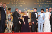 """Actor Joonas Suotamo, actress Thandie Newton, actor Woody Harrelson, director Ron Howard, actress Emilia Clarke, actor Alden Ehrenreich, actor Donald Glover, actress Phoebe Waller-Bridge and actor Paul Bettany attend the screening of """"Solo: A Star Wars Story"""" during the 71st annual Cannes Film Festival at Palais des Festivals on May 15, 2018 in Cannes, France."""