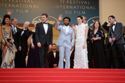 """Actor Thandie Newton, Woody Harrelson, director Ron Howard, Emilia Clarke, Alden Ehrenreich, Donald Glover, Phoebe Waller-Bridge and producer Kathleen Kennedy attend the screening of """"Solo: A Star Wars Story"""" during the 71st annual Cannes Film Festival at Palais des Festivals on May 15, 2018 in Cannes, France."""