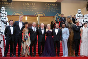 """Producer Simon Emanuel, actor Joonas Suotamo, actress Thandie Newton, actor Woody Harrelson, director Ron Howard, actress Emilia Clarke, actor Alden Ehrenreich, actor Donald Glover, Chewbacca, actor Paul Bettany and actress Phoebe Waller-Bridge attend the screening of """"Solo: A Star Wars Story"""" during the 71st annual Cannes Film Festival at Palais des Festivals on May 15, 2018 in Cannes, France."""