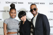 (L-R) Tashiana Washington, Son Jung Wan and Eric West pose backstage at the Son Jung Wan Fall 2016 fashion show during New York Fashion Week: The Shows at The Dock, Skylight at Moynihan Station on February 13, 2016 in New York City.