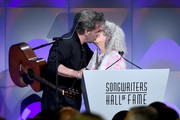 Songwriters Hall of Fame Inductee John Mellencamp accepts award from Nora Guthrie onstage during the Songwriters Hall of Fame 49th Annual Induction and Awards Dinner at New York Marriott Marquis Hotel on June 14, 2018 in New York City.
