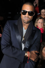 Kanye West amped up his dapper style in a stylish pair of rectangle shades.