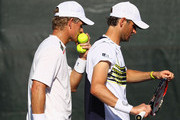 Mardy Fish of the USA and Mark Knowles of the Bahamas show their dejection against  Ross Hutchins and Colin Fleming of Great Britain during their first round doubles match at the Sony Ericsson Open at Crandon Park Tennis Center on March 23, 2012 in Key Biscayne, Florida.