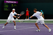 Mark Knowles and Mardy Fish of the United States play against Mikhail Youzhny and Igor Andreev during day six of the 2010 Sony Ericsson Open at Crandon Park Tennis Center on March 28, 2010 in Key Biscayne, Florida.