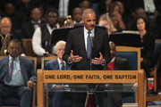 Former U.S. Attorney General Eric Holder speaks at the funeral for Aretha Franklin at the Greater Grace Temple on August 31, 2018 in Detroit, Michigan. Franklin, 76, died at her home in Detroit on August 16.