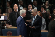 Former President Bill Clinton (L) and  former U.S. Attorney General Eric Holder attend the funeral for Aretha Franklin at the Greater Grace Temple on August 31, 2018 in Detroit, Michigan. Franklin died at 76 at her home in Detroit on August 16.