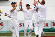 Graeme Swann and Kevin Pietersen of England celebrate with Stuart Broad after he took the wicket of AB de Villiers for 50 runs during day two of the second test match between South Africa and England at Kingsmead Stadium on December 27, 2009 in Durban, South Africa.