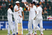 Jonny Bairstow of England is congratulated by James Anderson of England for catching out Dean Elgar of South Africa off Moeen Ali of England's bowling during day one of the 3rd Test at Wanderers Stadium on January 14, 2016 in Johannesburg, South Africa.