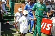 Imran Tahir walks out with a child during the 1st One Day International match between South Africa and India at Sahara Stadium, Kingsmead on January 12, 2011 in Durban, South Africa.