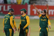 Imran Tahir of the Proteas celebrates the wicket of Dwayne Smith of the West Indies with his team mates during the 1st Momentum ODI between South Africa and West Indies at Sahara Stadium Kingsmead on January 16, 2015 in Durban, South Africa.