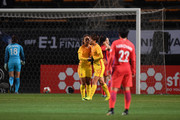 Zhang Rui (3rd L) of China celebrates scoring her side's second goal with her team mate Tang Jiali (2nd L) during the EAFF E-1 Women's Football Championship between South Korea and China at Fukuda Denshi Arena on December 15, 2017 in Chiba, Japan.