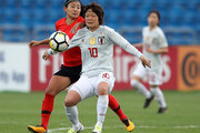 Mizuho Sakaguchi of Japan and Cho So Hyun of Korea battle for the ball in action during the AFC Women's Asian Cup Group B match between South Korea and Japan at the Amman International Stadium on April 10, 2018 in Amman, Jordan.