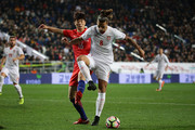 Aleksandar Prijovic of Serbia competes for the ball with Ki Sung-Yueng of South Korea during the international friendly match between South Korea and Serbia at Ulsan World Cup Stadium on November 14, 2017 in Ulsan, South Korea.