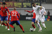 Christopher Wood of New Zealand compete for the ball with Han Kyo-Won of South Korea during the international friendly match between South Korea and New Zealand at Seoul World Cup Stadium on March 31, 2015 in Seoul, South Korea.