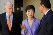 South Korean President Park Geun-hye (C) speaks with Los Angeles Mayor Antonio Villaraigosa (R) and California Governor Jerry Brown during a welcoming luncheon at the Getty House on May 9, 2013 in Los Angeles, California. Park will visit Korean business leaders in Los Angeles today as she continues a five-day, unity-building visit to the United States. Park has been in the United States since Monday, when she visited the United Nations. She met with President Barack Obama Tuesday and addressed a joint session of Congress Wednesday.