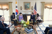 South Korean President Park Geun-hye (3rd L) speaks with Los Angeles Mayor Antonio Villaraigosa (2nd R) and California Governor Jerry Brown (L) as their translators listen in the foyer of Getty House after arriving for a welcoming luncheon on May 9, 2013 in Los Angeles, California. Park will visit Korean business leaders in Los Angeles today as she continues a five-day, unity-building visit to the United States. Park has been in the United States since Monday, when she visited the United Nations. She met with President Barack Obama Tuesday and addressed a joint session of Congress Wednesday.