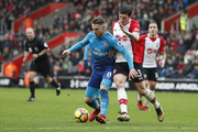 Arsenal's Welsh midfielder Aaron Ramsey (L) vies with Southampton's Danish midfielder Pierre-Emile Hojbjerg during the English Premier League football match between Southampton and Arsenal at St Mary's Stadium in Southampton, southern England on December 10, 2017. / AFP PHOTO / Adrian DENNIS / RESTRICTED TO EDITORIAL USE. No use with unauthorized audio, video, data, fixture lists, club/league logos or 'live' services. Online in-match use limited to 75 images, no video emulation. No use in betting, games or single club/league/player publications.  /