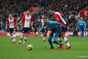 Aaron Ramsey of Arsenal and Virgil van Dijk of Southampton during the Premier League match between Southampton and Arsenal at St Mary's Stadium on December 10, 2017 in Southampton, England.
