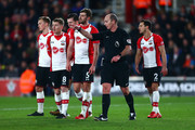Southampton players protest to referee Mike Dean after conceeding a penalty during the Premier League match between Southampton and Brighton and Hove Albion at St Mary's Stadium on January 31, 2018 in Southampton, England.