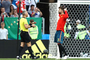 Gerard Pique of Spain confronts referee Bjorn Kuipers after he awards Russia a penalty for a hand ball from Gerard Pique of Spain inside the penalty area during the 2018 FIFA World Cup Russia Round of 16 match between Spain and Russia at Luzhniki Stadium on July 1, 2018 in Moscow, Russia.