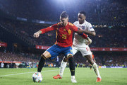 Raheem Sterling of England duels for the ball with Sergio Ramos of Spain during the UEFA Nations League A Group Four match between Spain and England at Estadio Benito Villamarin on October 15, 2018 in Seville, Spain.