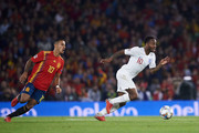 Raheem Sterling of England duels for the ball with Thiago Alcantara of Spain during the UEFA Nations League A Group Four match between Spain and England at Estadio Benito Villamarin on October 15, 2018 in Seville, Spain.