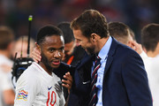 Gareth Southgate, Manager of England and Raheem Sterling of England celebrate victory after the UEFA Nations League A Group Four match between Spain and England at Estadio Benito Villamarin on October 15, 2018 in Seville, Spain.