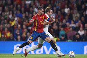 Harry Kane of England duels for the ball with  Sergio Ramos of Spain during the UEFA Nations League A Group Four match between Spain and England at Estadio Benito Villamarin on October 15, 2018 in Seville, Spain.