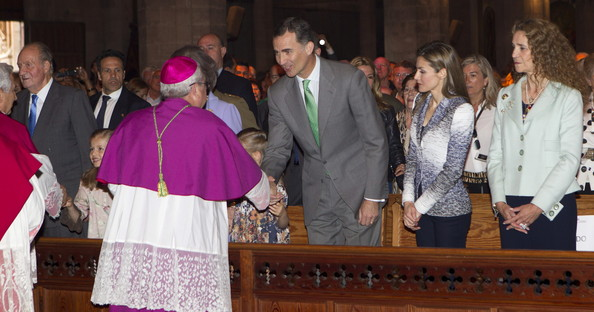 Bishop of Mallorca, Javier Salinas greets Prince Felipe of Spain, Princess Letizia of Spain and Princess Elena of Spain attend Easter Mass at the Cathedral of Palma de Mallorca on April 20, 2014 in Palma de Mallorca, Spain.