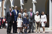 (L-R) Jesus Ortiz, King Felipe VI of Spain, Princess Sofia of Spain, Queen Sofia, Princess Leonor of Spain, Queen Letizia of Spain, King Juan Carlos, Menchu Alvarez and Paloma Rocasolano pose for the photographers after the First Communion of Princess Leonor of Spain at the Asuncion de Nuestra Senora Church on May 20, 2015 in Madrid, Spain.