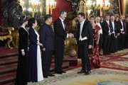(L-R) King Felipe VI of Spain,  Chinese president Xi Jinping, his wife Peng Liyuan and Queen Letizia of Spain receive Prime Minister Pedro Sanchez and wife Maria Begoña Gomez at the Gala Dinner in honour of Chinese president at the Royal Palace on November 28, 2018 in Madrid, Spain.