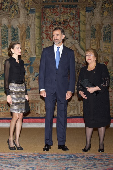 King Felipe VI of Spain (C), Queen Letizia of Spain (L) and Chilean President Michelle Bachelet (R) host a reception at the El Pardo Palace on October 30, 2014 in Madrid, Spain.