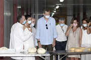 (2nd L-R) Queen Letizia of Spain, King Felipe VI of Spain, the Interior minister Fernando Grande Marlaska, the President of the Balearic Government Francina Armengol and the President Consell Insular de Menorca Susana Mora visit the Insular Livestock Cooperative (COINGA), in Alaior, the largest producer of emblematic cheese on the island of Menorca, on August 13, 2020 in Menorca, Spain.