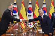 King Felipe VI (L) of Spain and South Korean President Moon Jae-in (R) shake hands prior their meeting at the presidential Blue House on October 23, 2019 in Seoul, South Korea. King Felipe VI of Spain and Queen Letizia of Spain are visiting South Korea for two days to discuss bilateral cooperation in sectors including economy and trade.
