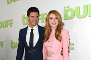 "Actors Robbie Amell (L) and Bella Thorne attend a special Los Angeles fan screening of ""THE DUFF"" on February 12, 2015 in Los Angeles, California."