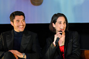"""Henry Golding (L) and Michelle Dockery speak onstage during the Special NY Screening of """"The Gentlemen"""" at the Alamo Drafthouse on January 11, 2020 in New York City."""