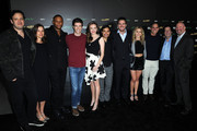 "(L-R) Andrew Kreisberg, Audrey Marie Anderson, David Ramsey, Grant Gustin, Danielle Panabaker,Carlos Valdes, Stephen Amell, Emily Bett Rickards, Greg Berlanti, Peter Roth and Marc Guggenheim arrive at a special screening for the CW's ""Arrow"" And ""The Flash"" at Crest Theatre on November 22, 2014 in Westwood, California."