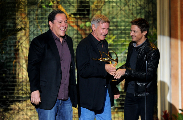 "(L-R) Actor Harrison Ford and director Jon Favreau accept the Most Man-Ticipated Movie award from actor Jeremy Renner onstage during Spike TV's 5th annual 2011 ""Guys Choice"" Awards at Sony Pictures Studios on June 4, 2011 in Culver City, California."