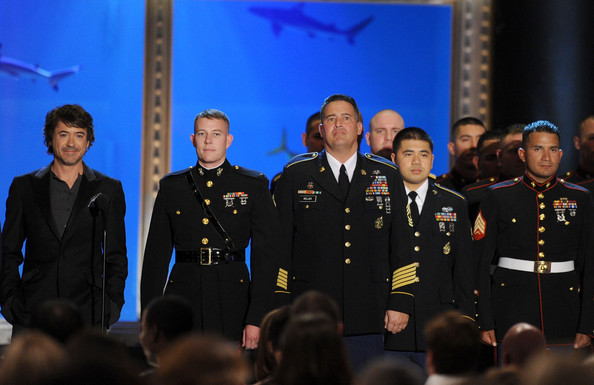 Actor Robert Downey Jr. (L) and United States military members the speak onstage during Spike TV's 4th Annual